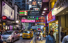 Hong Kong Street (Ben Heine) Tags: china street city people cars colors skyline composition canon buildings ads photography hongkong lights colorful asia magasin skyscrapers display notice harbour pavement lumière citylife restaurants exhibition advertisement busy commercial posters shops huge blocks activity publicity lightshow ville placard packed policemen harbourcity colorés sonetlumière artprints megapole bytheharbour canonmarkii benheineart streetbenheineart