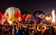 Dragon Fire (Doug Wallick) Tags: people moon hot wisconsin balloons fire evening glow dragon air celebration hudson annual affair