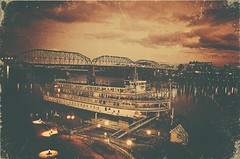 The Delta Queen (2) - Vintage Style Treatment (Roland 22) Tags: sky bw reflection chattanooga sepia night clouds vintage lights evening flickr glow tn tennessee northshore riverboat lamps steamboat walnutstreetbridge tennesseeriver bluffview coolidgepark deltaqueen deltaqueenhotelriverboat