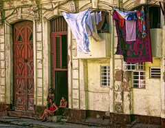 Street Scene, Havana Centro (Artypixall) Tags: building facade women sitting havana cuba streetscene clothes getty clotheslines faa frontdoors