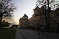 Chillon Castle at Sunset in Switzerland (` Toshio ') Tags: trees sunset people lake building castle history switzerland europe european path swiss medieval chillon lakegeneva toshio chilloncastle