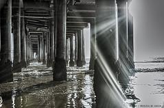 Under Santa Monica's Pier (Priscila de Cássia) Tags: ocean california wood sea usa sunlight reflection beach pier nikon waves santamonica fineart highcontrast flare sunrays hdr nikond90