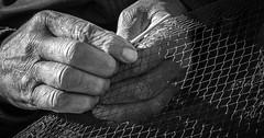 daily living (krllx) Tags: africa bw marokko sh scalatheport blackandwhite blue boats essaouira fishingnets fishingvillage fort habor hands menneske monochrome morocco people street streetphotograp dsc041882016030812