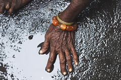 Her wrinkled hands wrought with pain  the kind only a homeless life can bring. (Bhavin Kaklotar) Tags: street camera canon photography photo flickr hand details picture streetphotography textures mumbai wrinkles handportrait canonphotography canon600d canoneos600d canont3i