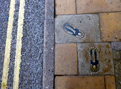 whose steps should we follow? (Jackal1) Tags: road street pavement steps sidewalk footprint doubleyellowlines ilfracombe