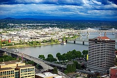 Aerial View of Portland Bridges (Herculeus.) Tags: city usa mountains water architecture clouds oregon buildings river portland landscape outside outdoors waterfront outdoor or highways roads willametteriver portlandcitygrill 5photosaday architectureinpixels 30thfloorview