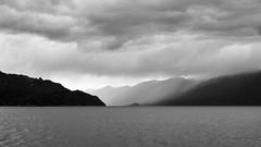 Crossing Kootenay Lake (claudeallaert) Tags: bw canada mountains rain ferry clouds rockies britishcolumbia manualfocus kootenaylake carlzeissplanar1750 sonyilce7 bc2016