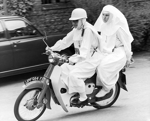 Sisters  Joan  and  Mary  Grace on 1968 Honda  C50.