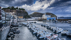 The harbour of Marina Corta - Lipari (Andrea Rapisarda) Tags: lipari marinacorta boats barche clouds sicily sicilia italia italy sony a6000 allrightsreserved eolie aeolianislands porto harbour 16mm