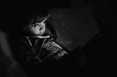 Concentration (Ana G. R.) Tags: blackandwhite girl relax reading bn inbed lowkey tablet atnight concentrated ipad