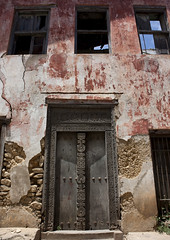 Old Door In Bagamoyo Stone Town, Tanzania (Eric Lafforgue) Tags: voyage africa door wood old travel house building history vertical architecture tanzania outdoors photography wooden carved photographie entrance culture nopeople historic carve doorway histoire porte stonetown maison oldbuilding bois ancien swahili afrique historique eastafrica bagamoyo entree pleinair buildingentrance tanzanie pwani exterieur colorpicture placeofinterest photocouleur decrepi afriquedelest colourpicture sculptee 3003tanzania