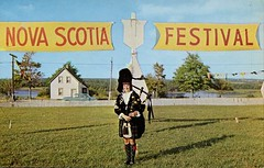 "A Nova Scotia Peach! This Charming Lassie Leads the ""Balmoral Girls Pipe Band"" at Stellarton NS (SwellMap) Tags: road signs monument public sign vintage advertising design 60s highway gate arch fifties message postcard suburbia entrance style kitsch retro billboard route nostalgia chrome freeway gateway billboards americana 50s lettering welcome roadside populuxe sixties babyboomer consumer coldwar midcentury spaceage atomicage archwaypc"
