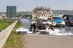 Crash on the highway. A Car catched fire. (borisss1982) Tags: auto cars car canon fire highway traffic crash smoke police autobahn autos feuer stau feuerwehr verkehr polizei firedepartment rauch unfall holdup policedepartment borisjordanphotography