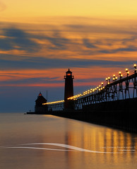 Grand Haven Pier at Night (Craig - S) Tags: statepark park sunset usa lighthouse tourism beach america reflections lights mirror golden evening pier midwest lighthouses glow michigan twinkle surface lakemichigan catwalk innerlight grandhaven starlights michiganstateparks outerlight