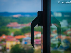 Life locked in a condominium (emdeelogy) Tags: blue sky green window glass trapped lock horizon condominium sealed