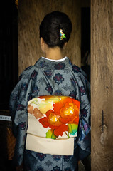 Girl in Kimono (temple door) (basvredeling) Tags: travel holiday fashion japan temple shrine clothes fabric kimono tradition tradtion geocity exif:iso_speed=1600 exif:focal_length=78mm exif:make=pentax camera:make=pentax geostate geocountrys exif:aperture=56 camera:model=pentaxk5 exif:model=pentaxk5 exif:lens=smcpentaxda18135mmf3556edalifdcwr