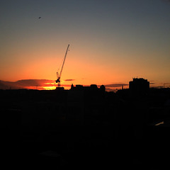 Sunset and a crane (yumtan) Tags: sunset london view