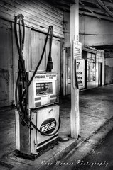 Old Fuel Pump - Black and White (Kaye Menner) Tags: street old blackandwhite building vintage post antique garage streetscene gas gasstation walkway worn shops petrol gasoline damaged oldtown footpath hdr oldbuilding fuel corroded petrolstation fuelpump petrolpump fillingstation petrolbowser gasolinepump kerbside oldfuelpump oldhdr fuelbowser streetpump kayemennerphotography kayemenner kayemennerheritageantique kayemennerblackandwhite damagedfuelpump fuelpumphdr
