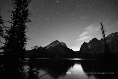 Jenny Lake at Night (Free Roaming Photography) Tags: trees sky usa mountain lake snow mountains west reflection water night forest dark stars star nationalpark spring woods reflect western northamerica nightsky wyoming teton tetons grandteton meteor jacksonhole darksky grandtetonnationalpark shootingstar jennylake glaciallake tetonmountains