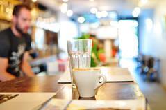 Cafe Pamenar (andreamaurice) Tags: toronto man glass digital 35mm cafe nikon focus market bokeh mug kensington latte barista macbook d5000