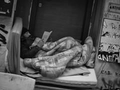 Homeless, reading; Athens, Exarchia (kohlmann.sascha) Tags: street blackandwhite blancoynegro buch lesen reading book clothing media dress noiretblanc availablelight library homeless bibliothek streetphotography hellas social athens clothes greece grecia cap atenas monochrom schwarzweiss griechenland derelict grce medien mtze biancoenero streetperson sansabri bcher athen kleidung headgear itinrant sintecho exarchia athnes sozial senzatetto bekleidung ellda obdachlos  atene  obdachloser schwarzweis  barbona roughsleeper homelessperson athna ells kopfbedeckung  sansdomicilefixe athnai streetfotografie   strasenfotografie    eldesamparado elindigente