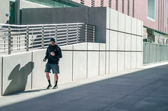 His Shadow Walks with Him (Dennis_Shinpaugh) Tags: boy shadow building guy college metal stone walking photography phone rail walkway shorts beanie iphone