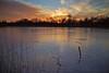 Twilight frozen catchment pond