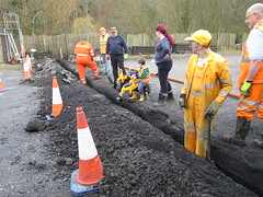The gang and JCB dig the trench across the yard 8Mar15