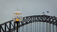 Golden Globe and Bridge (Theen ...) Tags: sky glass metal lumix grey globe day cloudy dusk streetlamp sydney australia circularquay flags glowing naval harbourbridge theen