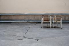 Residential amenities (jannemyl) Tags: urban table helsinki chair backyard kallio furniture bleakness asphalt stillness inneryard