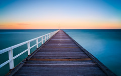 Seaford Pier (Pen Photo) Tags: ocean bridge blue sunset red sea cloud abstract building tower geometric water lines skyline architecture night zeiss sunrise canon landscape bay pier photo still angle 21 outdoor dusk timber border rustic wide smooth australia melbourne victoria structure symmetry trail walkway lee carl nd infrastructure vic serene mm minimalism aus filters grad frankston graduated density neutral