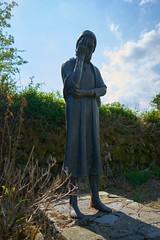 Weeping Mother , Dungarvan Ireland Famine Graveyard (Michael C Dean) Tags: ireland graveyard statue zeiss sony cemetary a7 famine 25mm batis dungarvan a7ii batis225