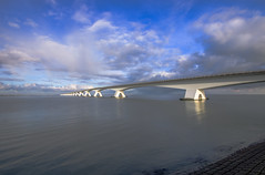 5022 mtr long bridge called Zeelandbrug (Pascal vd Wassenberg) Tags: road longexposure bridge blue winter light sea sky cloud white lake abstract holland reflection art texture nature wet water netherlands field yellow skyline architecture clouds river landscape concrete outside photography grey seaside nice alley long quiet fotografie view dynamic outdoor good sony air tripod extreme ngc wide nederland natuur sigma atmosphere wideangle zeeland awsome filter northsea simplicity serene plain 1020 kats 1965 landschap monopod natuurmonumenten cokin oosterschelde statief cantileverbridge distanse n256