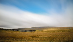 Ribblehead Viaduct (Ashley Hemsley) Tags: camera york trip bridge blue england white holiday motion art nature colors beauty weather clouds speed canon skyscape season point photography countryside spring movement focus long exposure artist skies peace shot wind walk unique yorkshire united horizon creative railway kingdom landmark visit tourist hills explore filter nd shutter change 5d dslr breeze distance dales cloudsscape zomei triainline