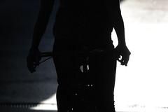 Cyclist in an unlit underpass, Basel, Switzerland (John A Briody) Tags: light shadow woman white black dark underpass switzerland nikon cyclist basel d750 brakes sillhouette handlebars