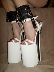 Platform Sandals Showing Extreme Angled Footbed (KAFOmaker) Tags: white12inchplatformsandals bondage heel heels platform platforms sandal sandals ankle strap straps strapped anklestrap sexy leather cuff chain chains chained lock locks locked locking