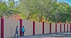 The Tall Wall (Jo-Cooling To 80's :)) Tags: blue trees light red sky brown building boys wall walking beige shadows walk albuquerque tall walkers odc