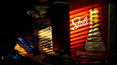 P1020831d (jmctuna) Tags: light shadow sun lumix panasonic stoli boxes stolichnaya duraflame jmctuna fz200