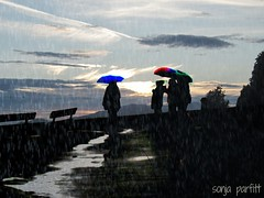 spring showers (Sonja Parfitt) Tags: color umbrella englishbay westend layered