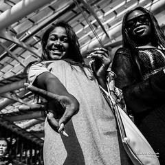 Street - She saw me ;-) (Franois Escriva) Tags: street city people urban bw sun white black paris france cute girl beautiful smile sunglasses pretty noir candid fingers streetphotography olympus victory nb v blanc halles omd