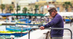 An old fisherman on shore (zilverbat.) Tags: portrait people photography scenery dof image bokeh candid streetphotography streetlife streetscene malta streetshot candidphotography streetcandid straatfotografie