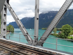 Brnig-train-bridge at Interlaken (faberlatusm - 50 mio views) Tags: railroad bridge blue green tourism water sunglasses landscape switzerland breasts erotic brienzersee sensual flashing teasing interlaken aare blackdress bottomless flashinpublic