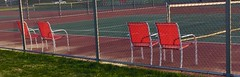 And the game goes on (sharonhorning) Tags: red net fence four pattern chairs tenniscourt