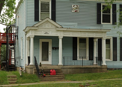 Porch, Blackleach-Hughs House  Oxford, Ohio (Pythaglio) Tags: county windows ohio house altered early columns steps vinyl 11 historic sidewalk oxford frame butler shutters siding residence twostory staircases pediment bulging paneling cornice returns dwelling 1835 1898 remodeled paneled hughs entasis blackleach juliuspringles ca1817 but1661