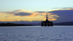 Sun setting on an oil rig (IrenicRhonda) Tags: sunset sea industry public coast scotland highlands unitedkingdom scenic escocia forth cromarty oilrig blackisle schottland ecosse gbr invergordon cromartyfirth rossshire easterross highlandsandislands p4m 500px lascozia coastreflection geo:lat=5768979065 geo:lon=418315172 p4mportfolio