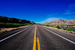 Route 66 (boldlyatomicwerewolf) Tags: road blue arizona sky usa sun dessert route66 long yellowline westernusa fujixt1 samyang12mmf2