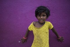 Girl in Yellow (Ravikanth K) Tags: 500px girl curious shy hands pink yellow kid children outdoor purple bangles costume village tamilnadu vedanthangal people travel tshirt cute lovely beautiful kunnavakkam wall portrait leaning nikond750