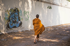 Juxtaposition (tylerkingphotography) Tags: city travel boy orange art wall walking thailand photography graffiti alley nikon southeastasia photographer outdoor buddhist religion young monk buddhism explore backpacking thai 1855mm traveling amateur d3100