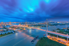 Cityscape - The Bhumibol Bridge also known as the Industrial Ring Road Bridge against raining cloudy sky in Bangkok, Thailand. - Cool tone or cold city style (Gos Eye View) Tags: road city bridge blue light sunset sky urban building water architecture night river landscape thailand evening design harbor high twilight construction highway industrial commerce cityscape power view cross suspension bangkok transport scenic engineering landmark structure ring east business transportation freeway thai huge coaster connection connect mega phraya bhumibol