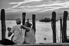 Sunset with drink - Venice (February29) Tags: contaxg 90mm f28 sony a7 venezia venice pellestrina sunset drink girl man hug summer laguna lagoon bw bianconero controluce backlight manualfocus innamorati inlove martini campari prosecco romantic romantico mare sea